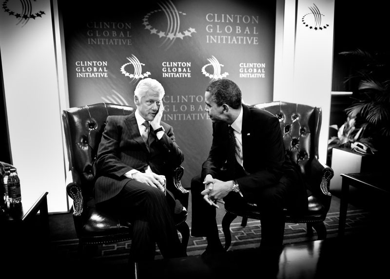 Former President Bill Clinton and President Barack Obama share a quiet moment backstage before Obama speaks to the crowd at the Clinton Global Initiative Annual Meeting in New York on September 25, 2012.