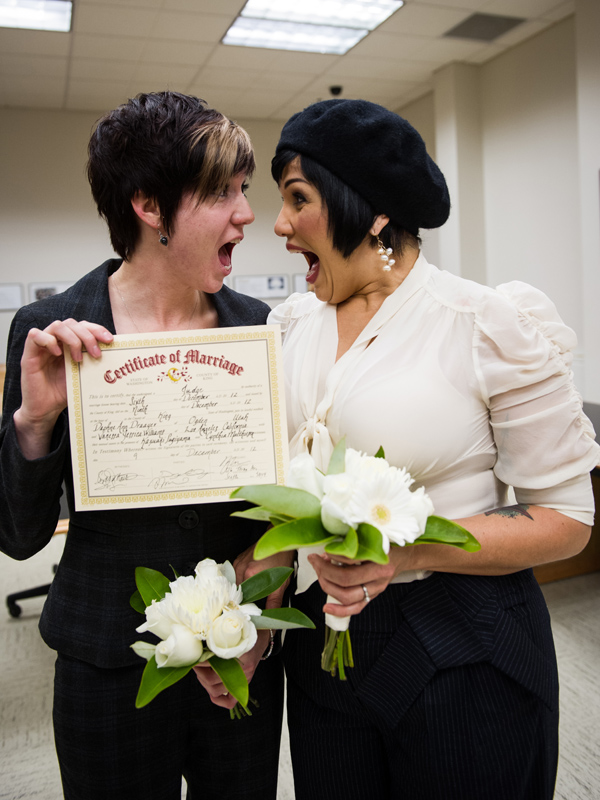 Daphne Draayer and Vanessa Williams show off their marriage certificate.