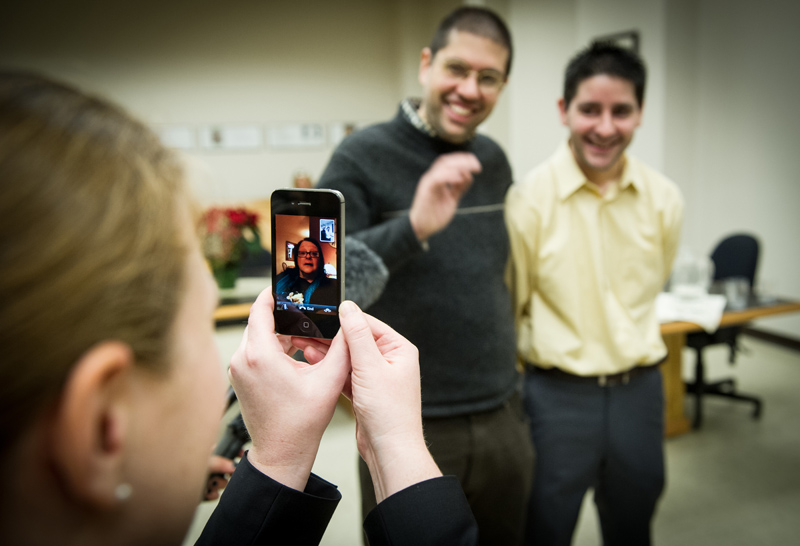 """Anthony Delos and Andrew Heidke are married as they """"Facetime"""" with Anthony's mother in Milwaukee."""