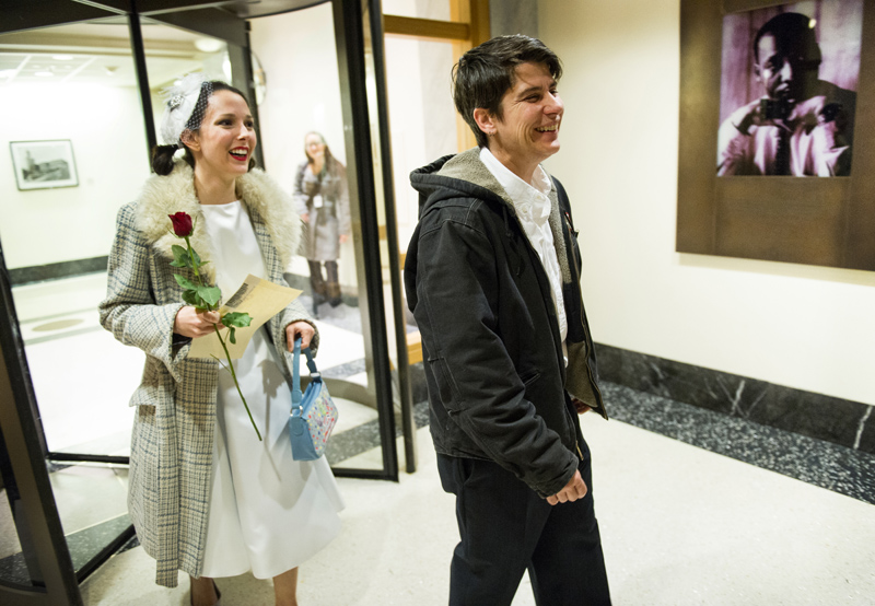 Stephanie Lyon and Margaret Ryan exit the King County Courthouse after being married by Judge Mary Yu.