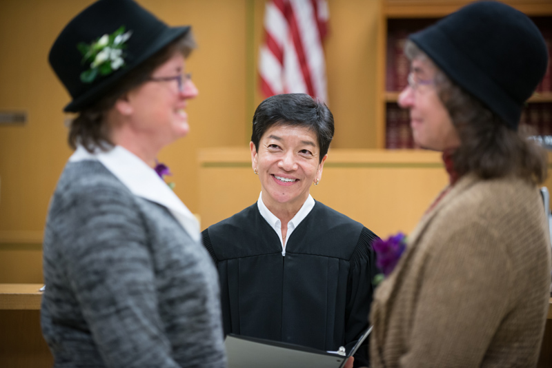 Judge Mary Yu performs a wedding ceremony for Sherry Bockwinkel and Cindee Moore.