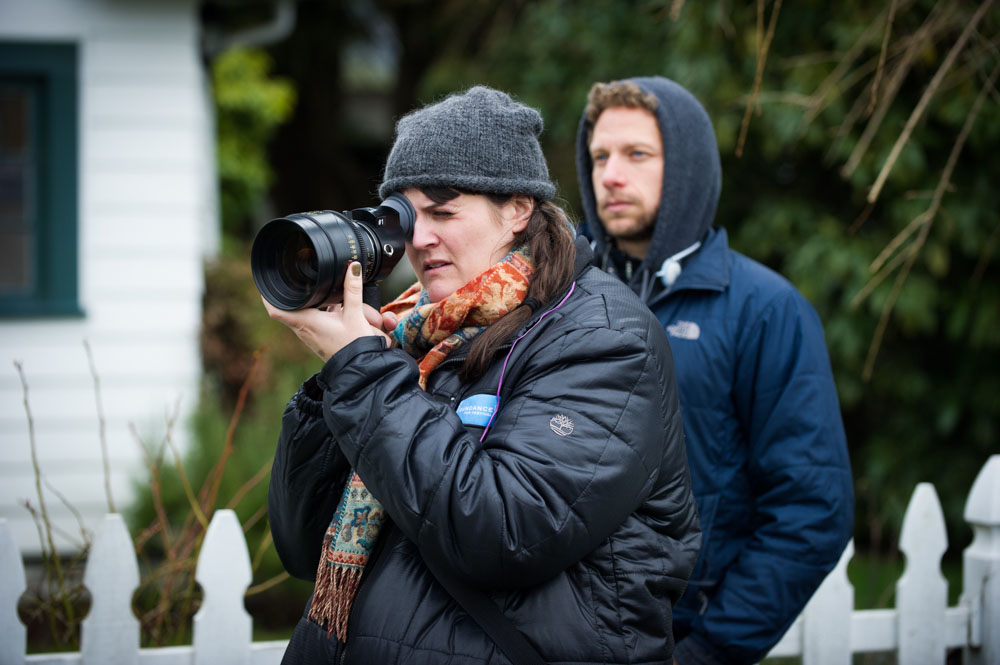 "Director Megan Griffiths on the set of ""Lucky Them"" with director of photography Ben Kuchins."