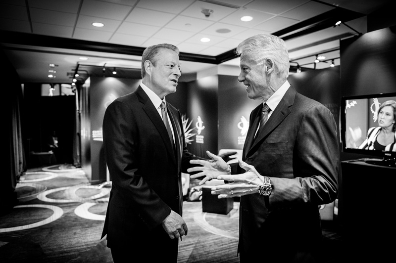 Former Vice President Al Gore and former President Bill Clinton share a moment backstage at the Clinton Global Initiative in New York on September 24, 2013.