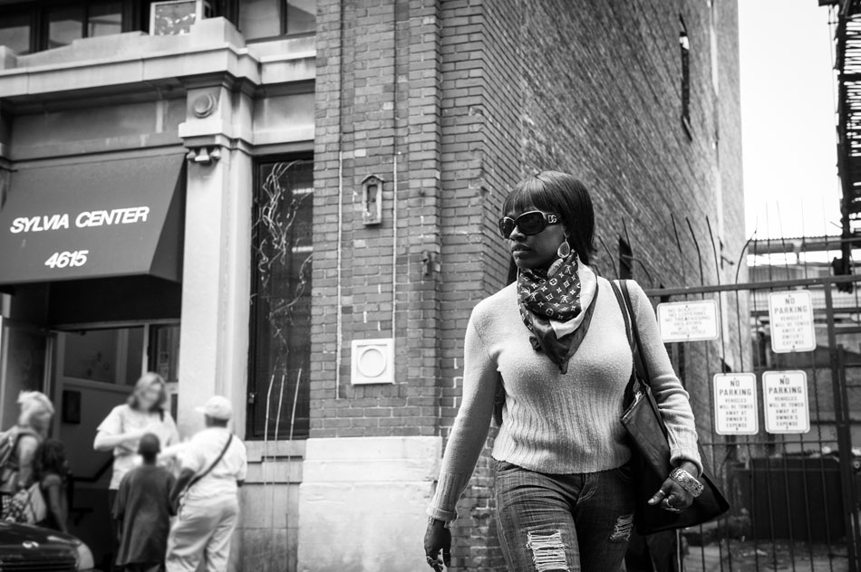 Chrystal Thompson standing outside the homeless shelter where she and son Mecca Owens were recently living in Chicago, IL. At the time of this photograph, they were temporarily living in a friend's apartment in a senior housing development.