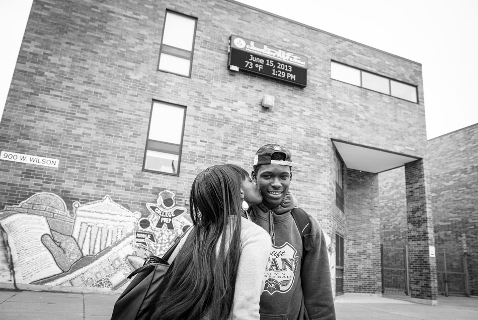Chrystal Thompson and son Mecca Owens in Chicago, IL in front of his high school.