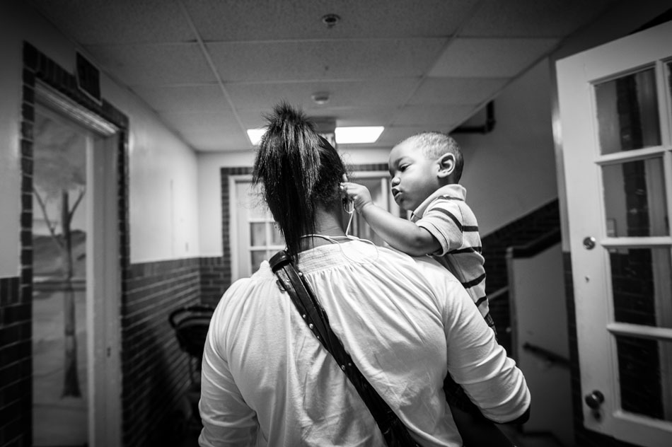 Dolliethea Sandridge drops off her son Josiah at the Chambliss Center for Children on August 22, 2013 in Chattanooga, TN.
