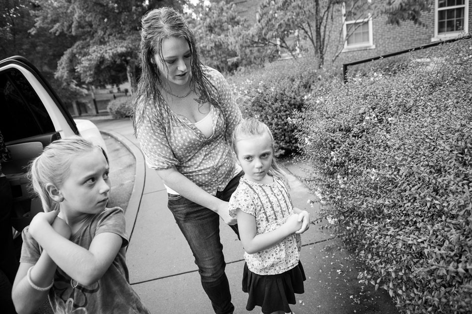Katrina Gilbert, with daughters Brooklynn, 7-years-old, and Lydia, 5-years-old, arrive at the Chambliss Center for Children to pick up son Trent, 3-years-old on August 21, 2013 in Chattanooga, TN.